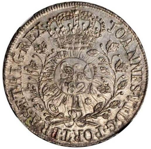960 réis de 1821 recunahdo sobre 8 soles argentino